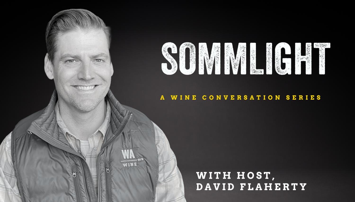 """black and white image of a man wearing a button up shirt and vest, smiling at the camera. """"Sommlight A Wine Conversation with Host, David Flaherty"""" is over the dark background."""