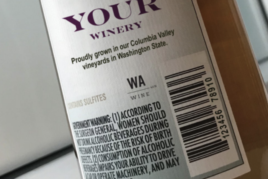 A wine bottle label with the the WA Wine logo placed in the middle.