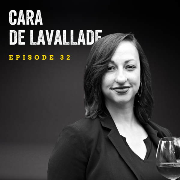 """black and white image of a woman with dark medium length hair with a slight smile on her face. She is wearing a dark blazer and holds a glass of wine. Overlaid is the text, """"Cara de Lavallade Episode 32."""""""