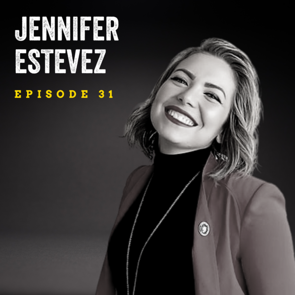 black and white image of a woman (Jennifer Estevez) with shoulder-length hair smiling at the camera, wearing a blazer and dark turtleneck. Jennifer Estevez, episode 31 is overlaid in the top left corner