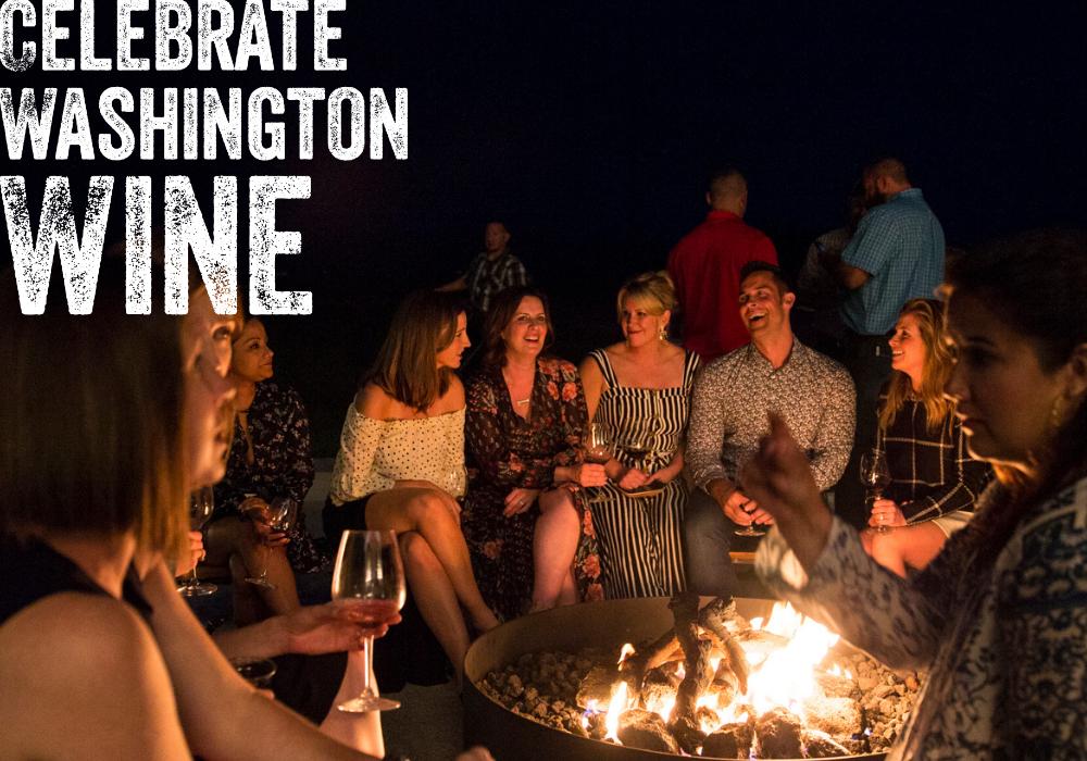 friends enjoying Washington wine around a fire